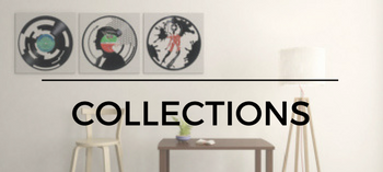 collection of art on framed vinyl records